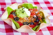 a texmex taco salad in a baked tortilla