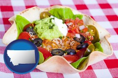 montana map icon and a texmex taco salad in a baked tortilla