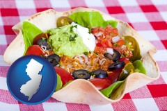new-jersey map icon and a texmex taco salad in a baked tortilla