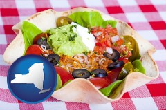 new-york map icon and a texmex taco salad in a baked tortilla