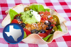 texas a texmex taco salad in a baked tortilla