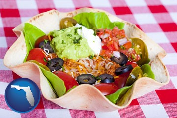 a texmex taco salad in a baked tortilla - with Florida icon