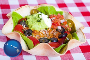 a texmex taco salad in a baked tortilla - with Hawaii icon