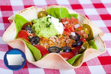a texmex taco salad in a baked tortilla - with Iowa icon