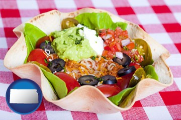 a texmex taco salad in a baked tortilla - with Kansas icon
