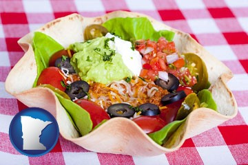 a texmex taco salad in a baked tortilla - with Minnesota icon