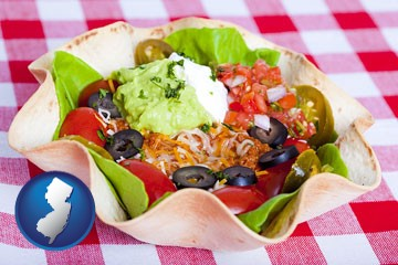 a texmex taco salad in a baked tortilla - with New Jersey icon