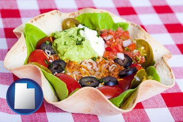a texmex taco salad in a baked tortilla - with Utah icon